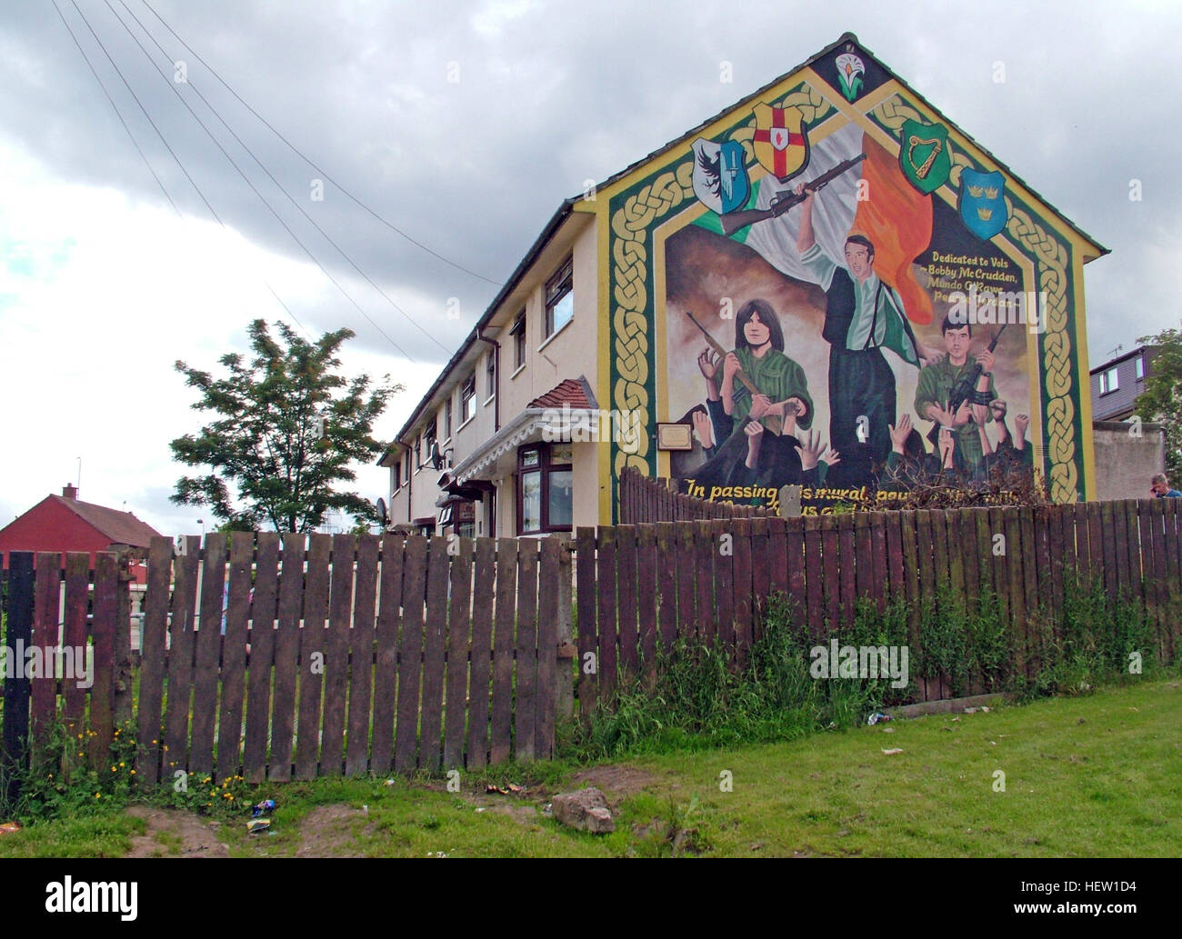Belfast Falls Rd Republican Mural on council house gable end - Stock Image