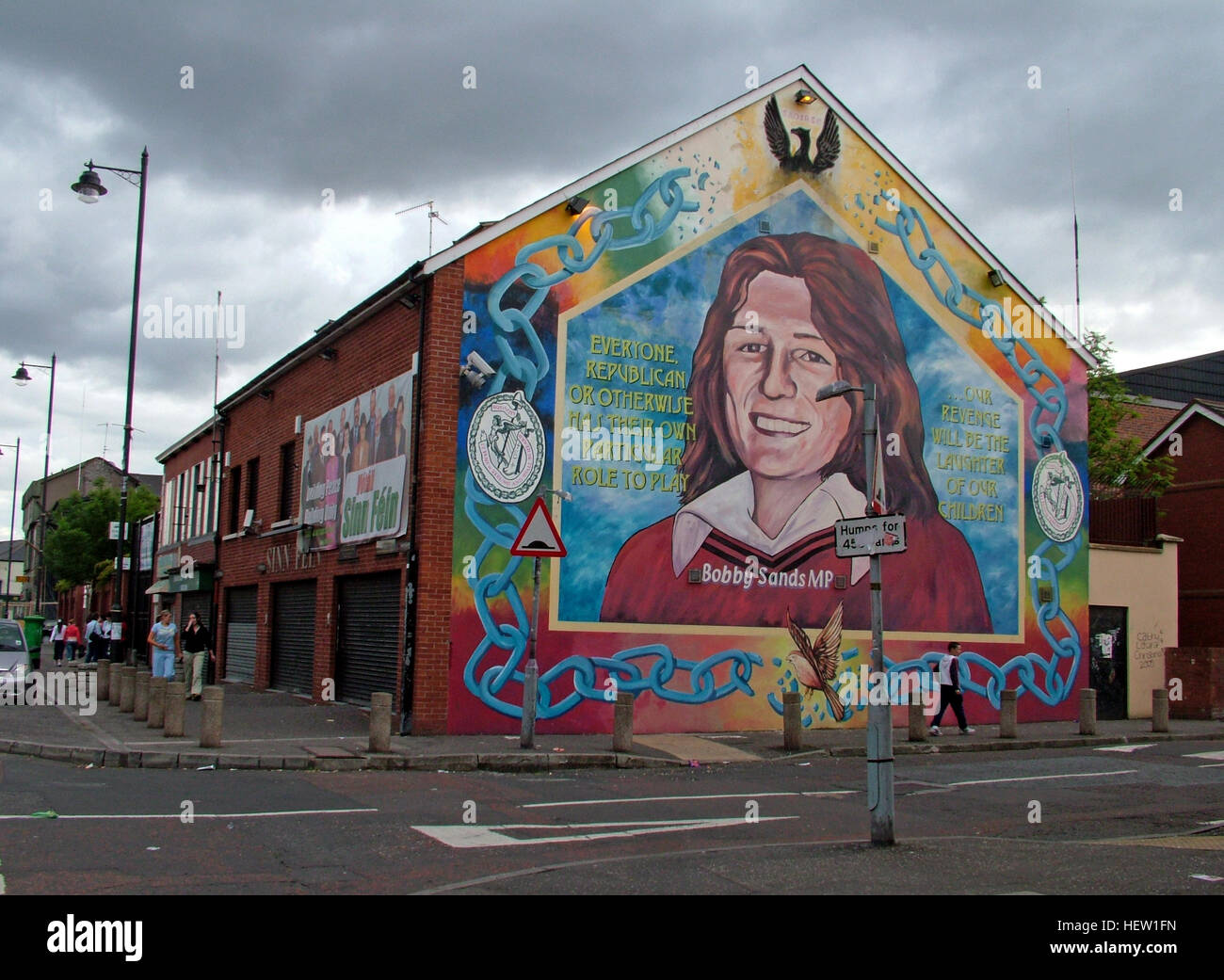 Belfast Falls Rd Republican Mural- Bobby Sands MP & Sinn Fein Office - dark skies - Stock Image