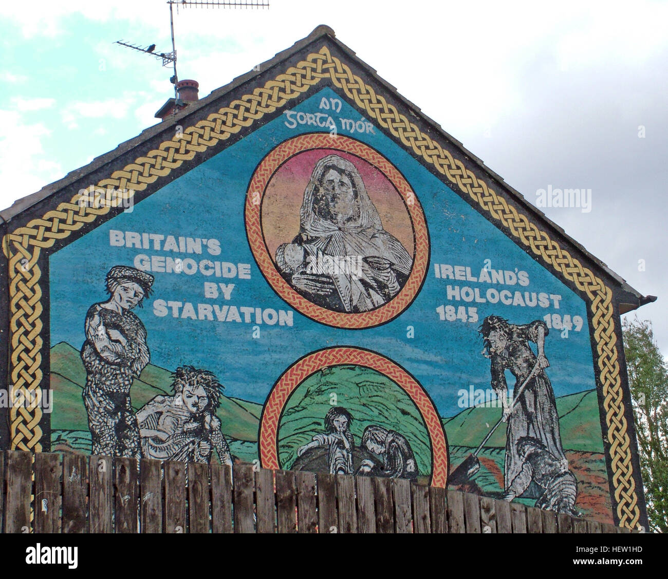Belfast Falls Rd Republican Mural-Britains Genocide By Starvation, Irelands Holocaust on housing estate gable end - Stock Image