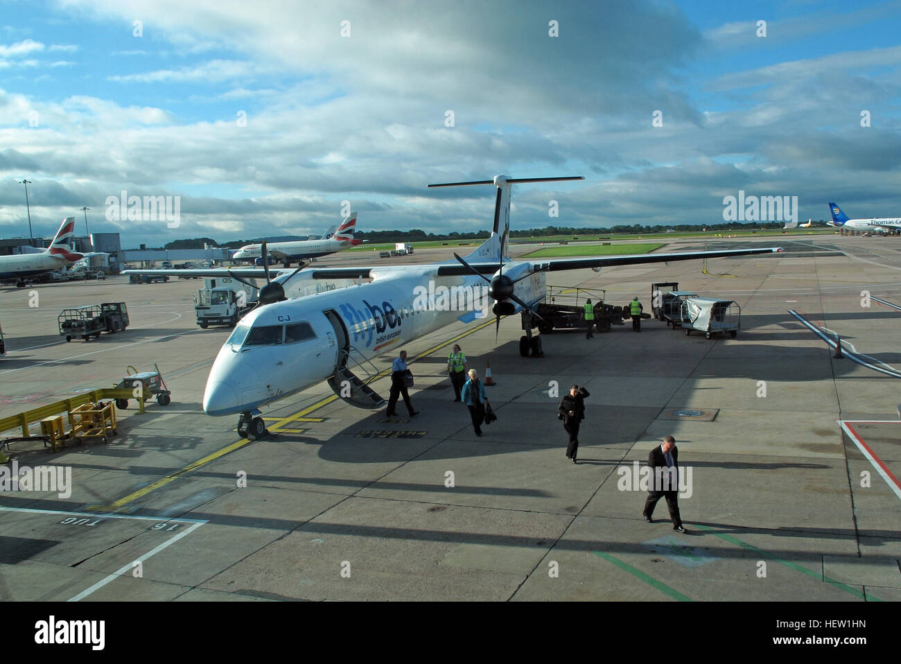 Flybe air plane G-JECJ Bombardier Dash-8 Q400 arriving Manchester Ringway Airport, England, UK - Stock Image
