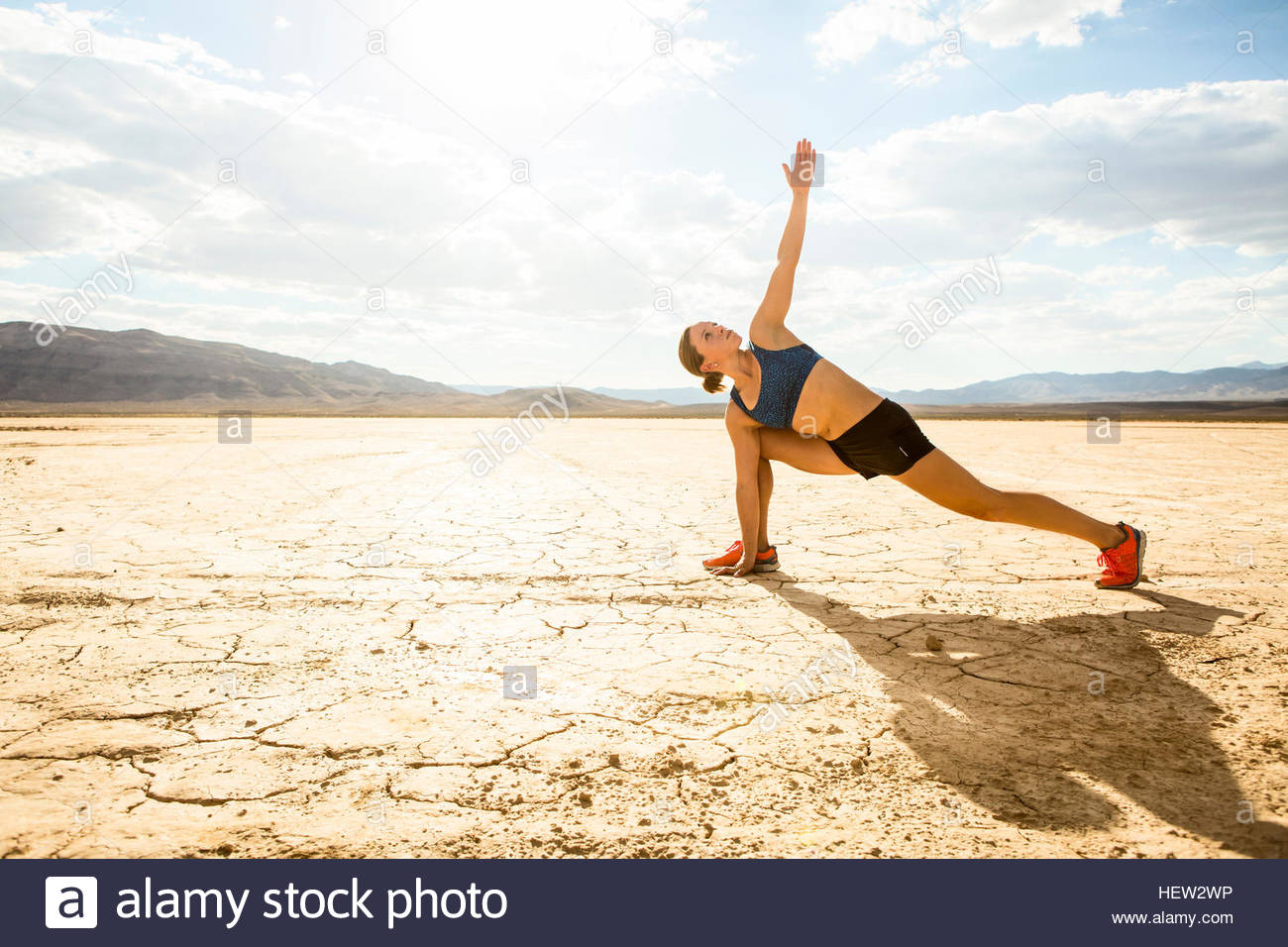 Runner in side plank pose in desert, Las Vegas, Nevada, USA - Stock Image