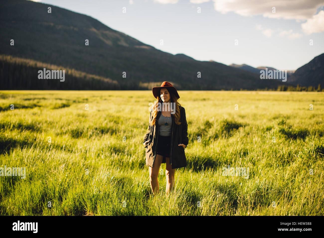 Woman walking in meadow, Rocky Mountain National Park, Colorado, USA - Stock Image