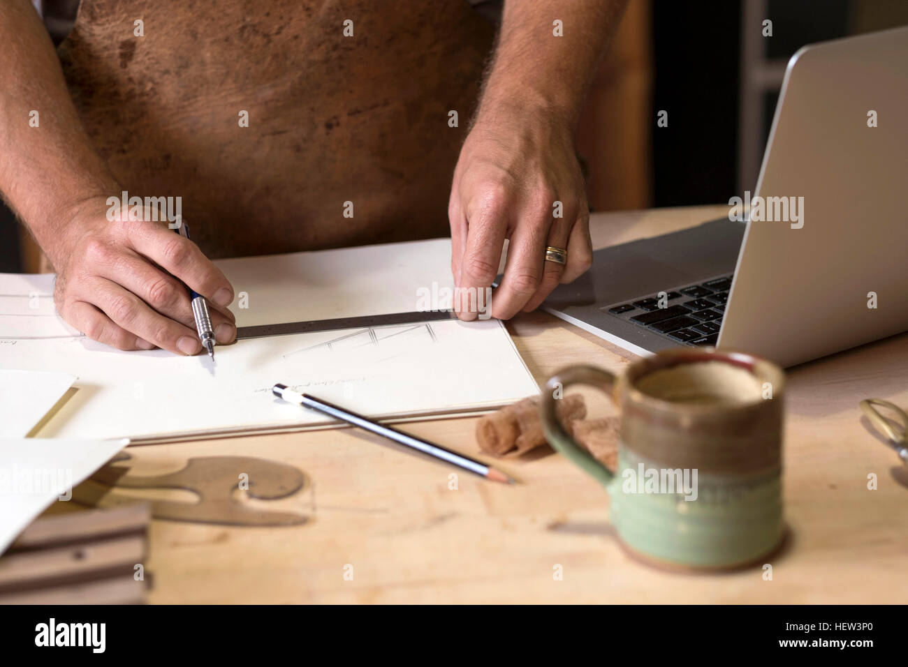 Carpenter at his workshop, close up view of hand drawing - Stock Image