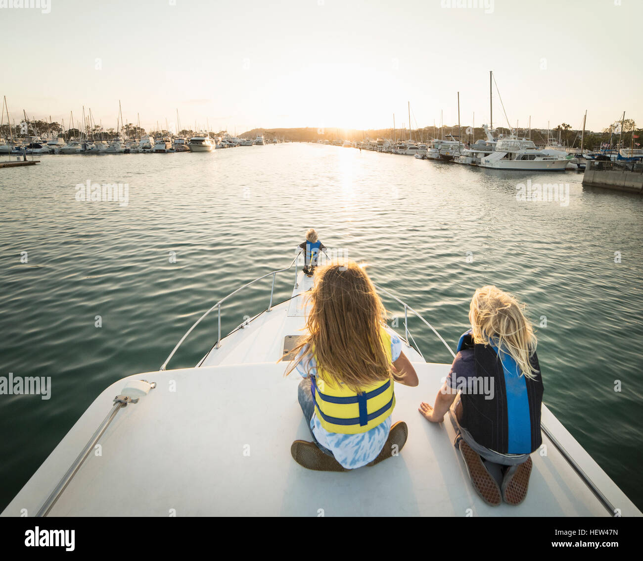 Rear view of children on bow of boat, Dana Point, California, USA - Stock Image