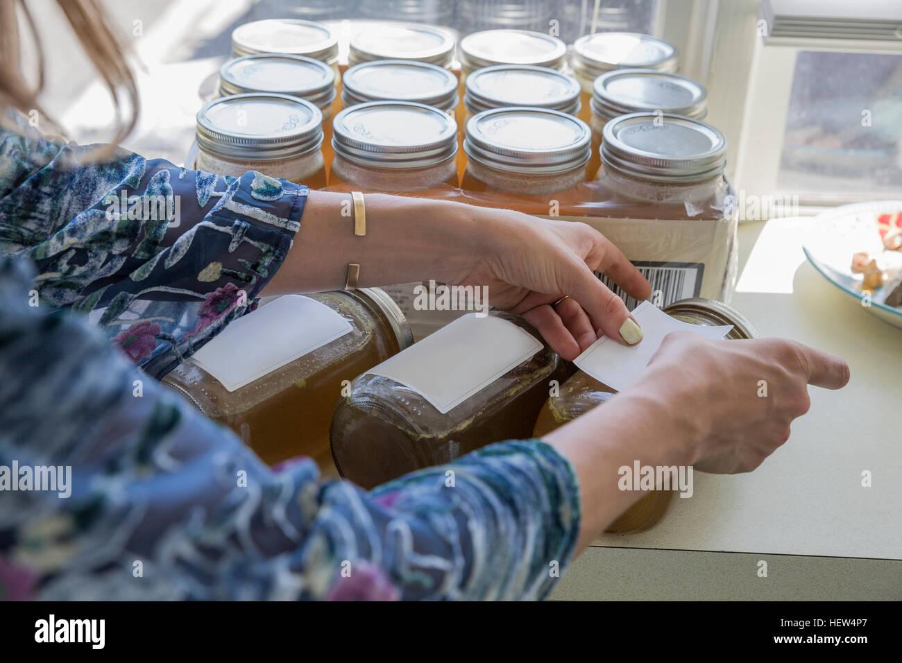 Women labelling jars - Stock Image