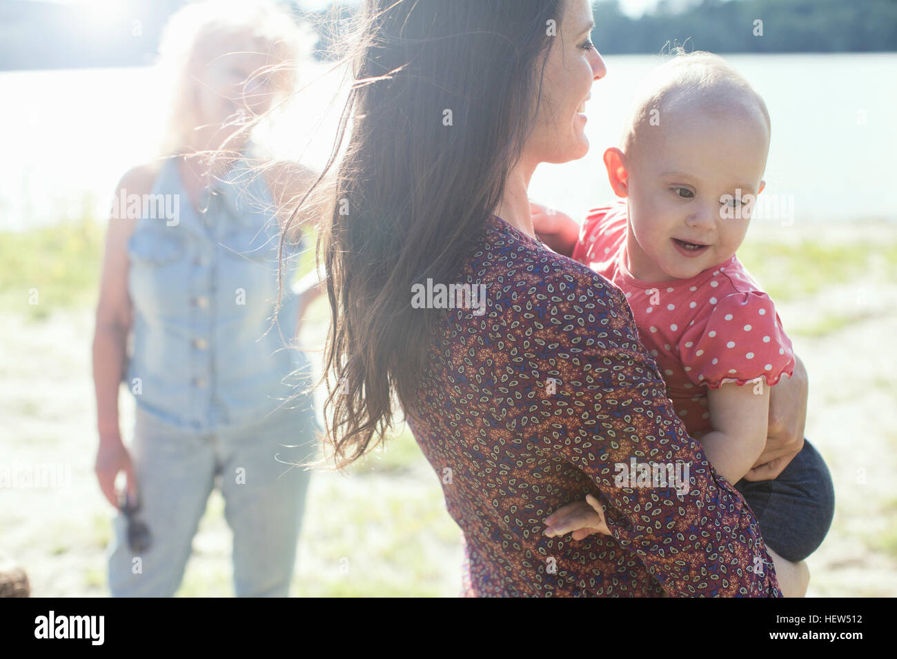 Senior woman with daughter and granddaughter at riverside - Stock Image