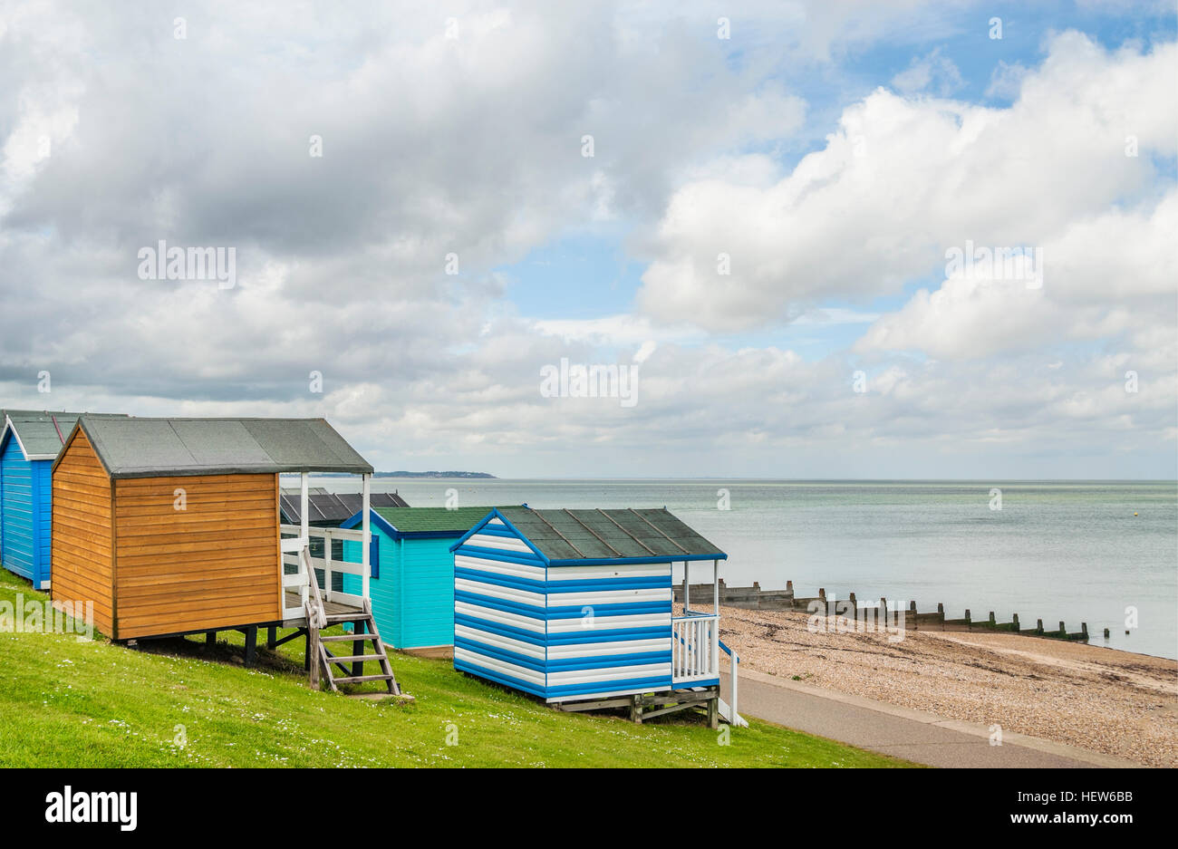 Whitstable, Kent, England, UK, Britain, Europe. Colourful beach huts overlooking the Thames estuary on the north - Stock Image
