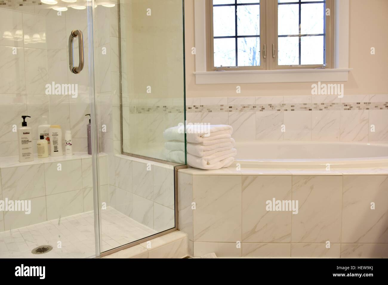 A Luxury White Marble Bathroom In A Modern Home Stock Photo Alamy