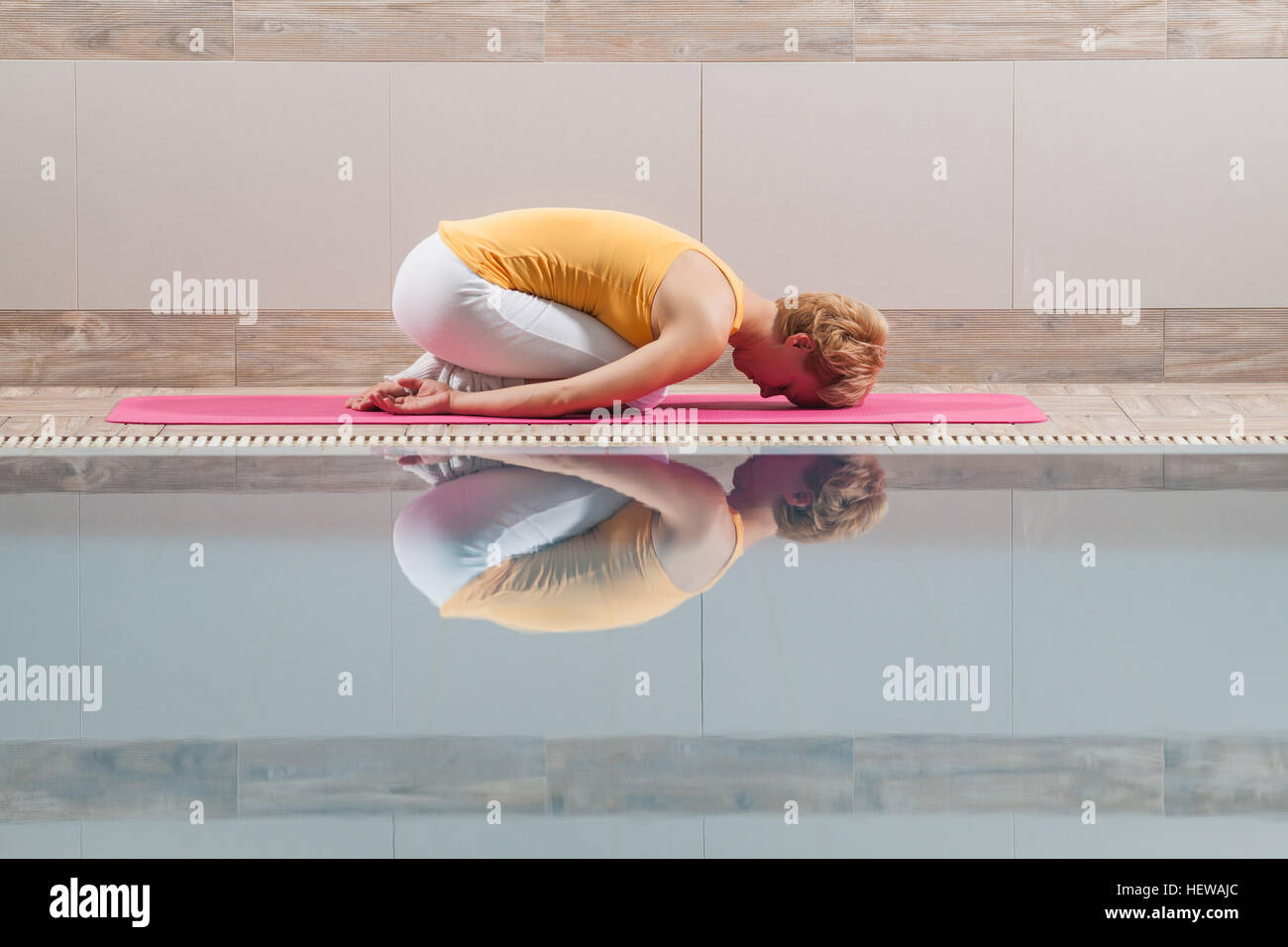 Young woman is practicing yoga. - Stock Image