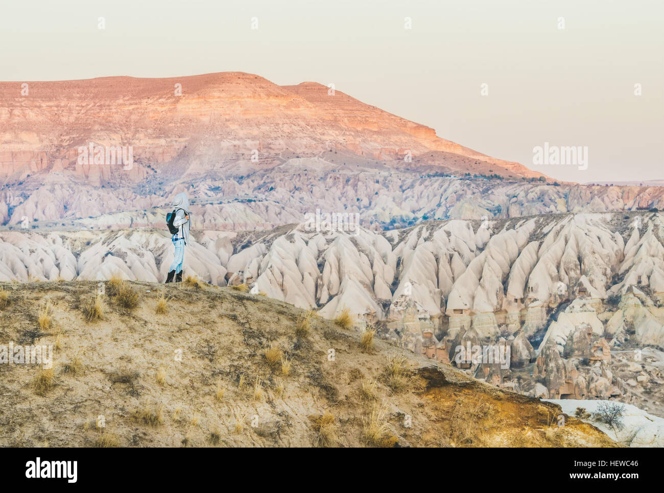Young woman traveller hiking in mountains in Cappadocia, Turkey Stock Photo