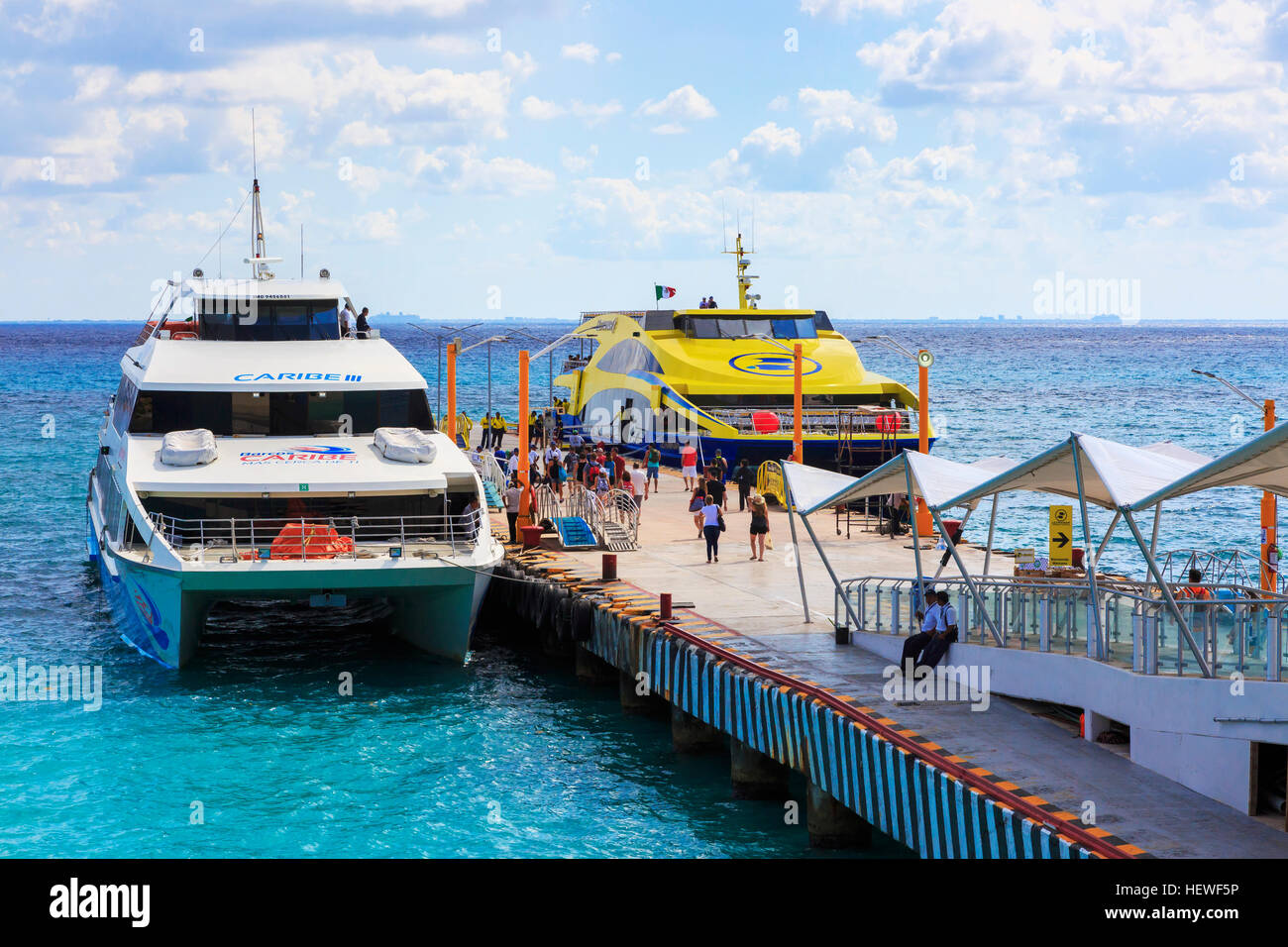 Ferries at the pier at Playa Del Carmen, Riviera Mya, Mexico. Ferries sail to Cozumel - Stock Image