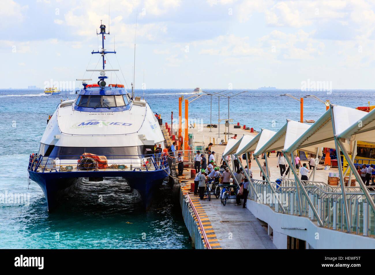 Ferries at the pier at Playa Del Carmen, Riviera Maya, Mexico. Ferries sail to Cozumel - Stock Image