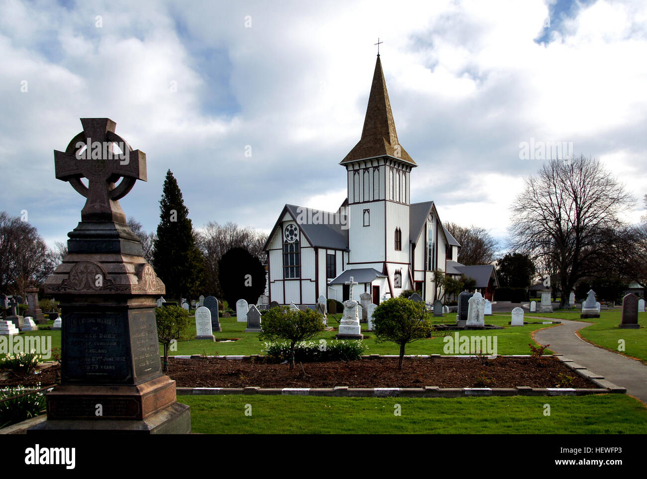 St Paul's Church and Churchyard have a strong visual presence in the centre of the suburb of Papanui and are - Stock Image