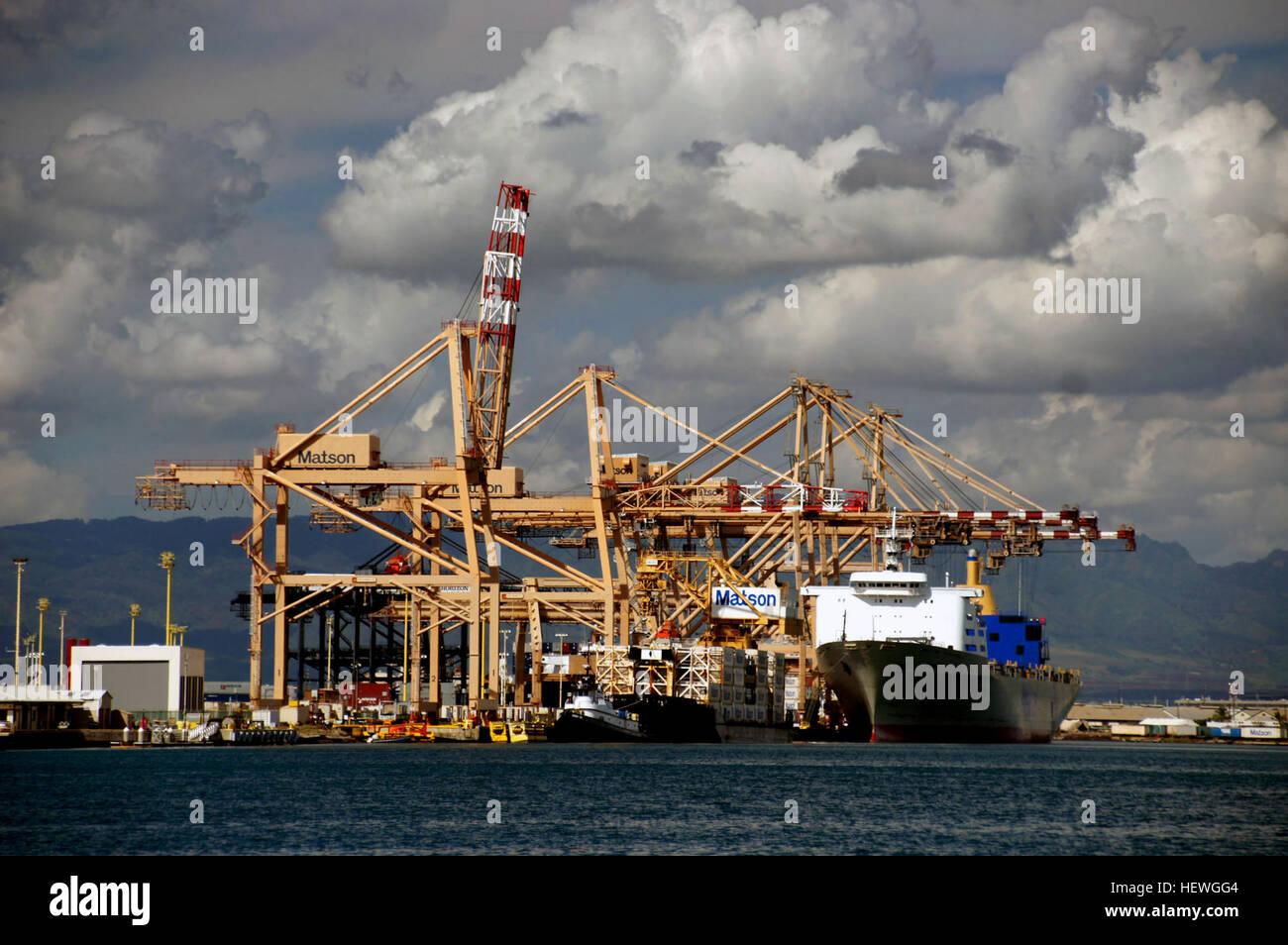 Honolulu Harbor, also called Kulolia and Ke Awa O Kou, is the principal seaport of Honolulu and the State of Hawaiʻi - Stock Image
