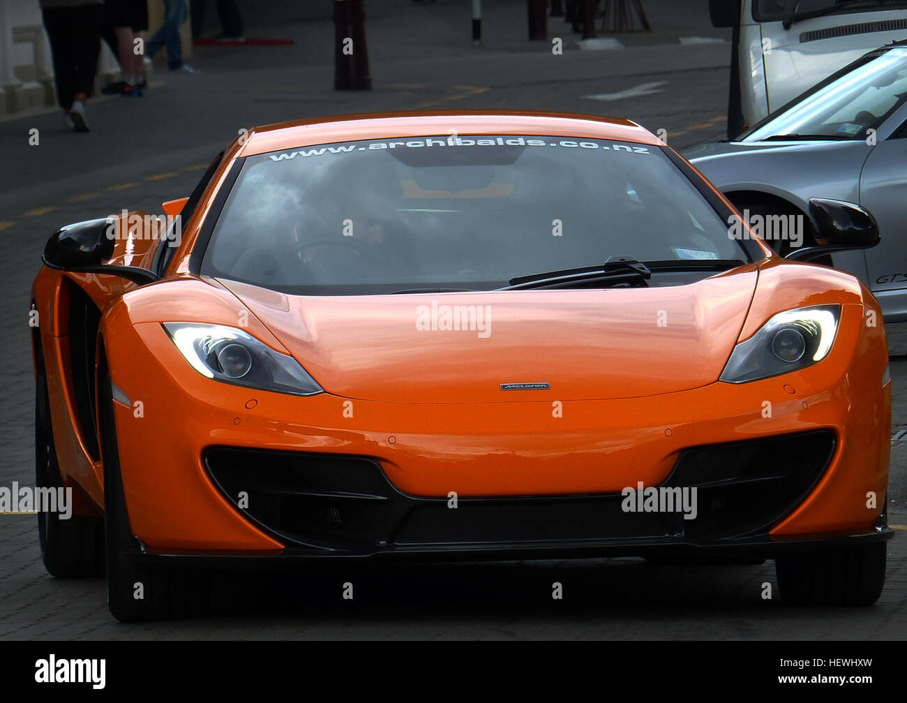 The McLaren MP4-12C, later known simply as the McLaren 12C,  is a supercar designed and manufactured by McLaren - Stock Image