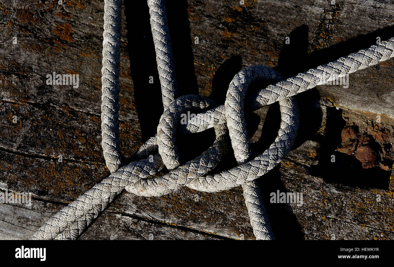 Clove Hitch A simple all-purpose hitch. Easy to tie and untie. A useful and easy to tie knot, the Clove Hitch is Stock Photo