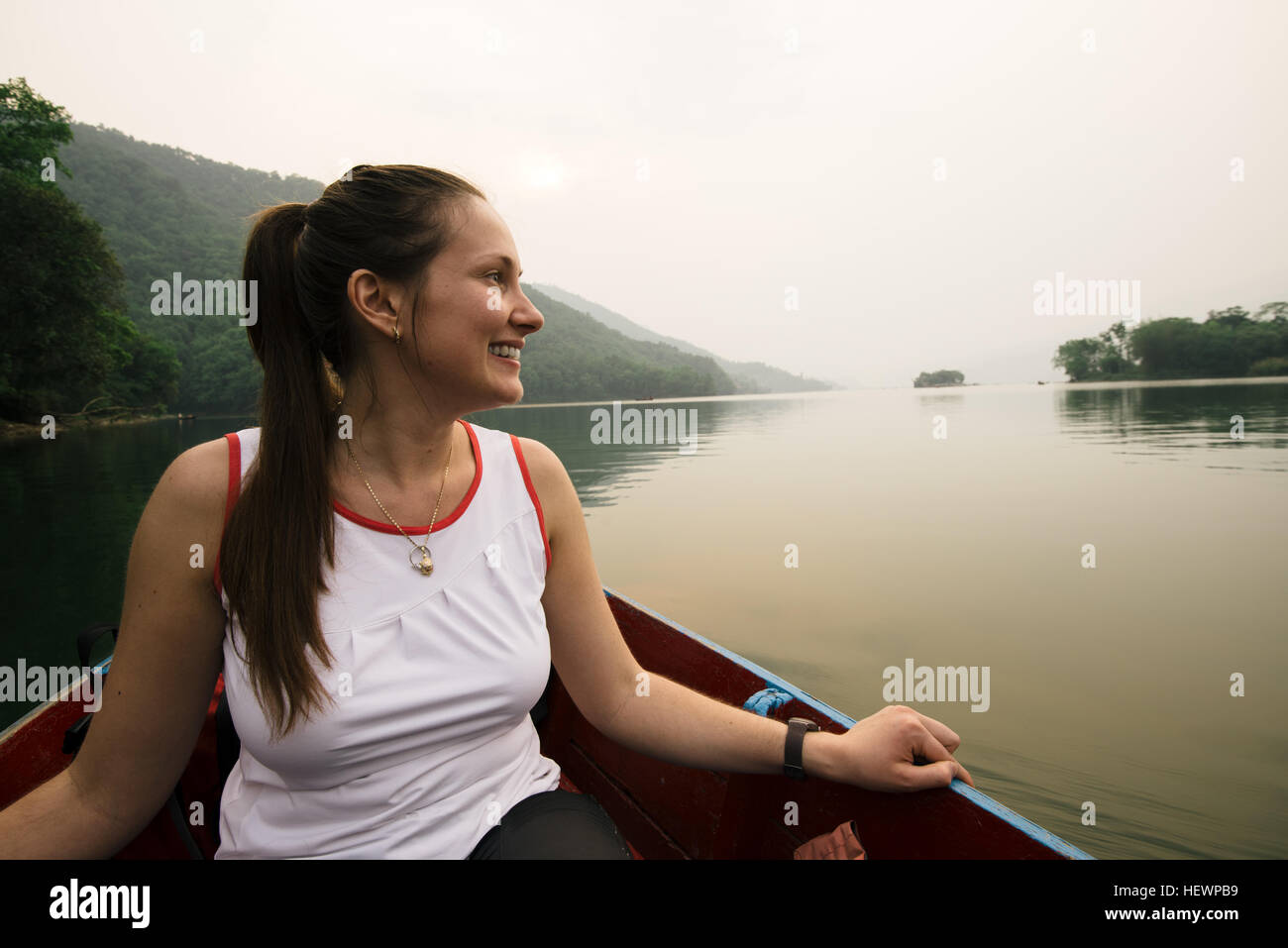 Woman on boat on lake, Pokhara, Nepal - Stock Image