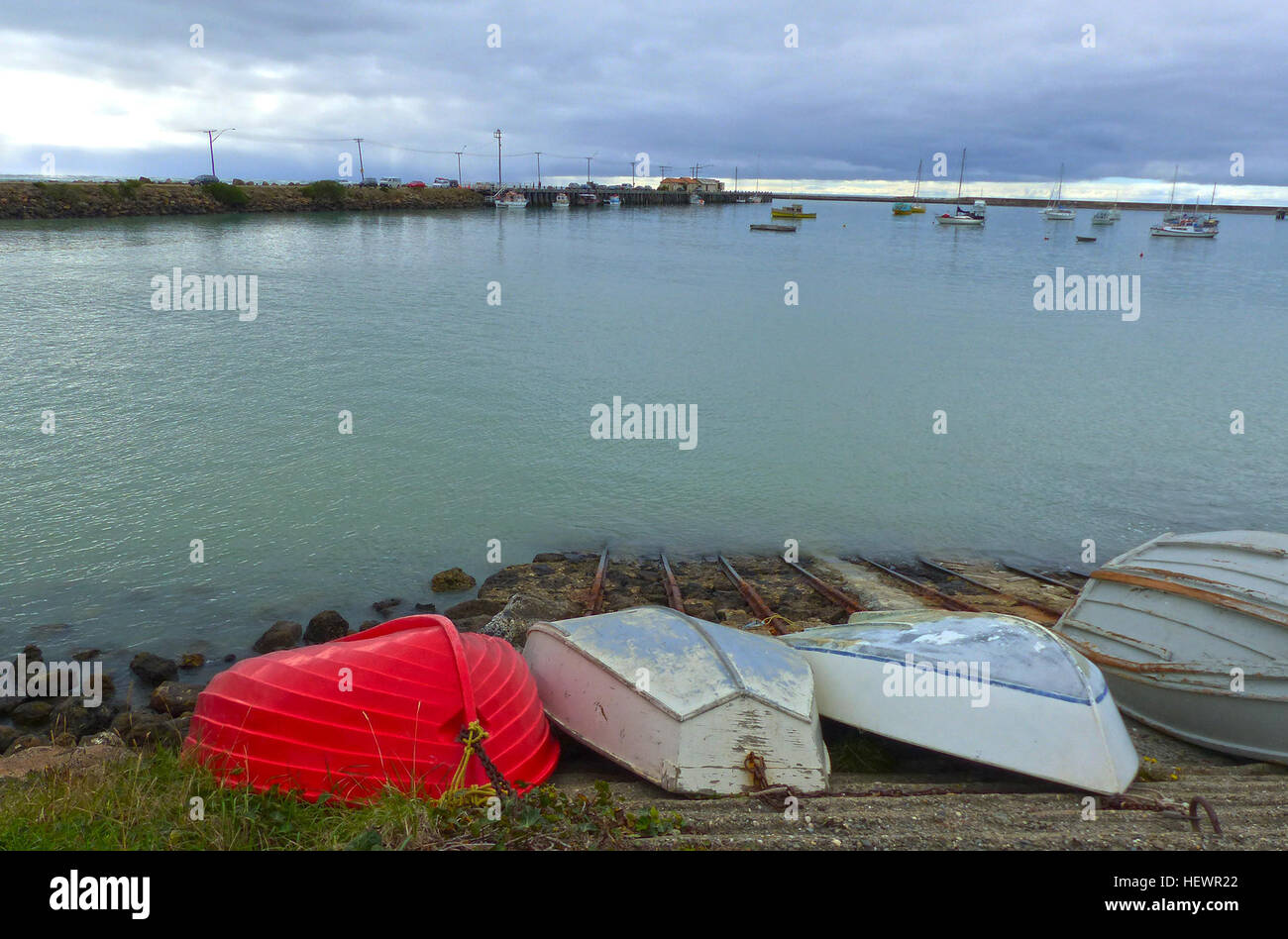 A dinghy (or dingey) is a type of small boat, often carried or towed for use as a ship's boat by a larger vessel. - Stock Image