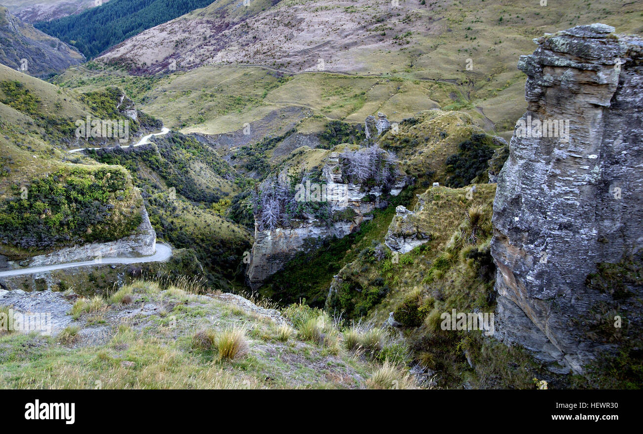Skippers Road clings to the side of Skippers Canyon, which drops vertically to the Shotover River, once known as - Stock Image