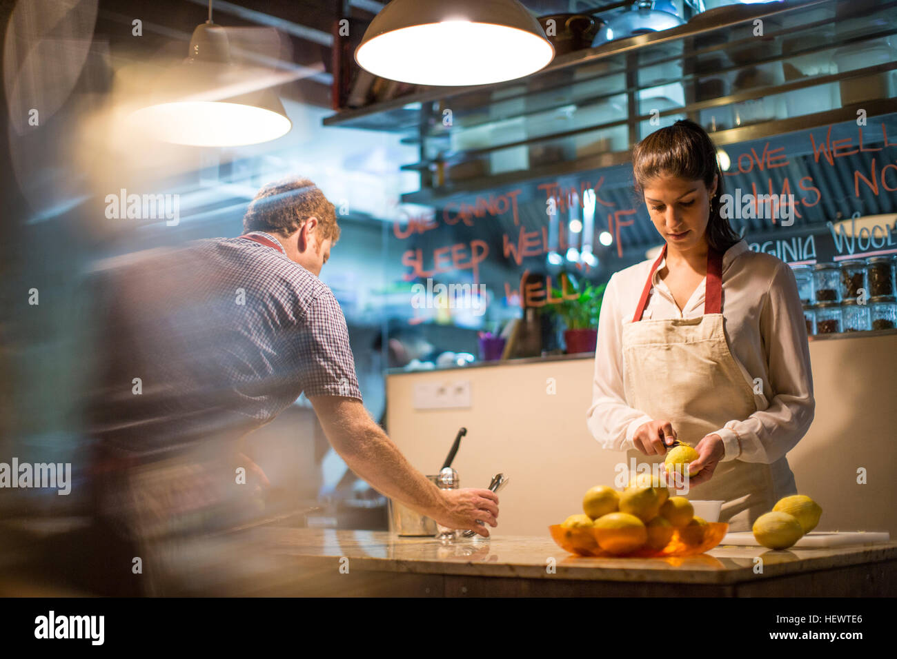 Restaurant owners working in kitchen - Stock Image