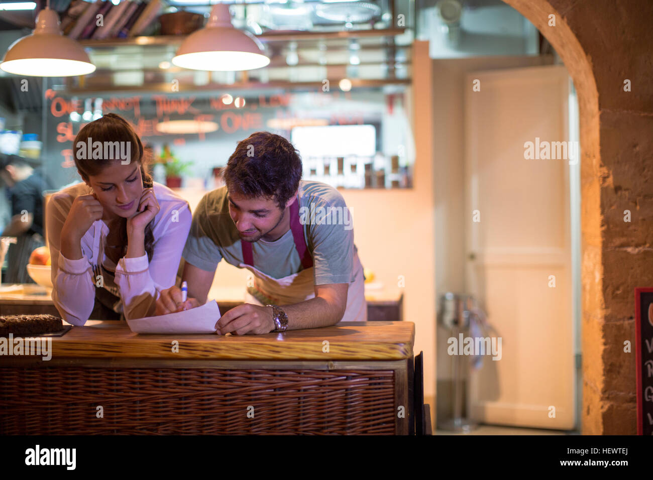 Restaurant owners working in kitchen Stock Photo
