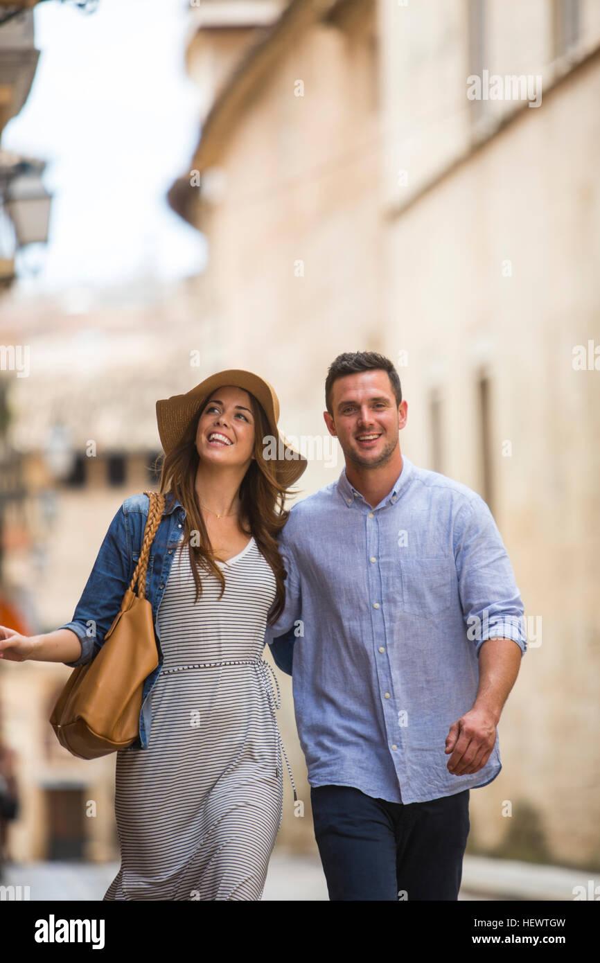Couple walking on street, Palma de Mallorca, Spain - Stock Image