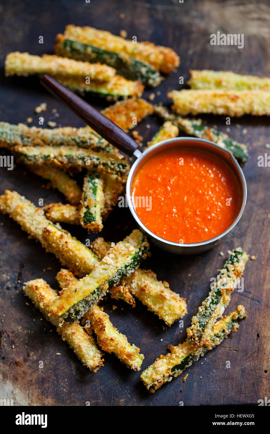 Zucchini fires with roast pepper and tomato sauce Stock Photo