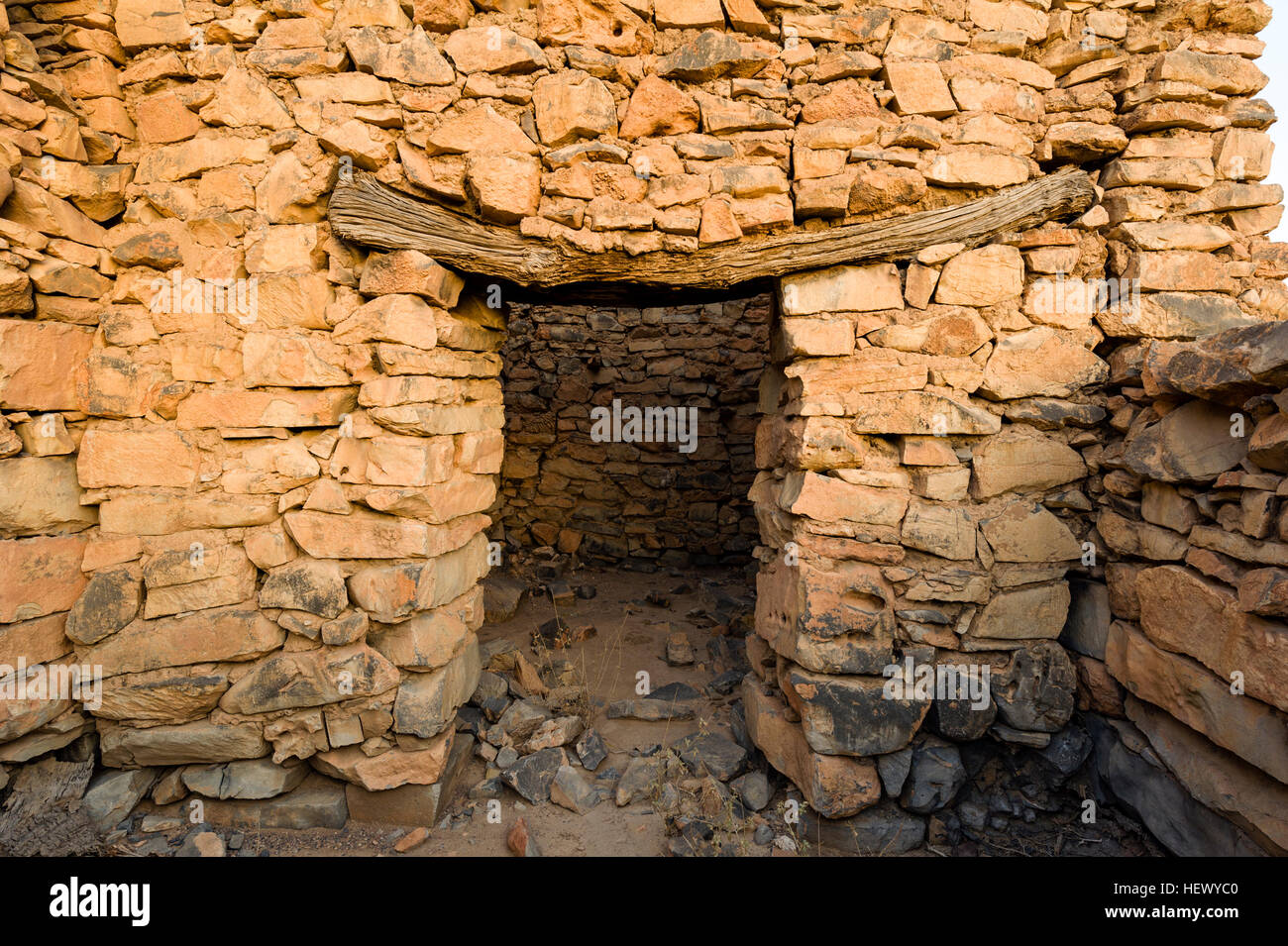 An Ancient Handmade Stone Building Wall And Timber Door