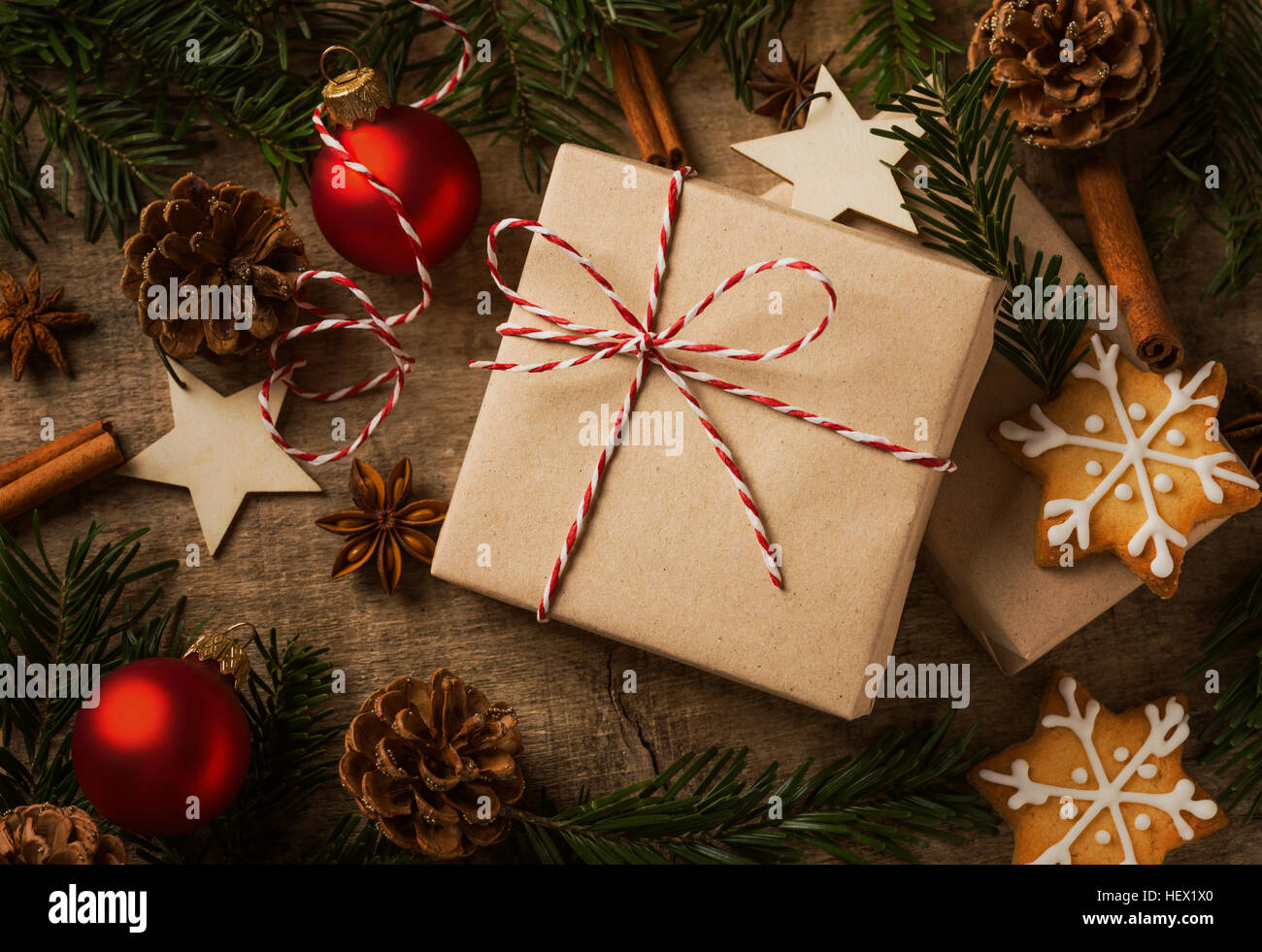 Christmas present wrapped in kraft paper with natural decoration - Stock Image