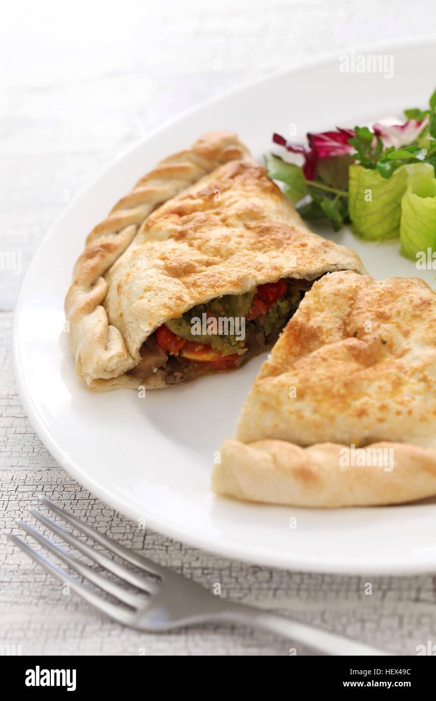 calzone, folded stuffed pizza, italian food - Stock Image