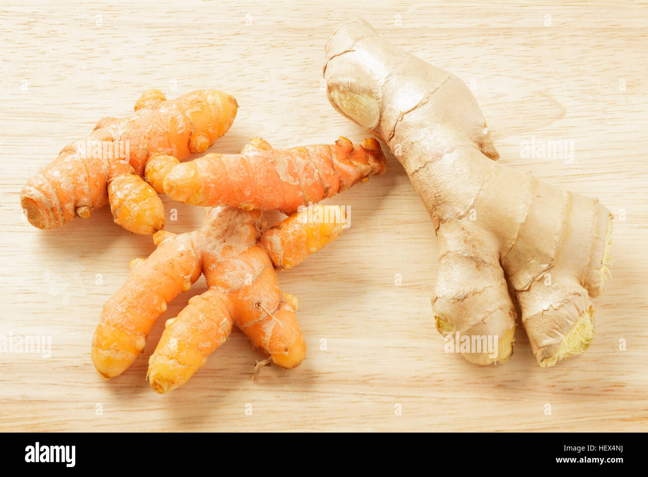 Fresh turmeric root and fresh ginger root - Stock Image