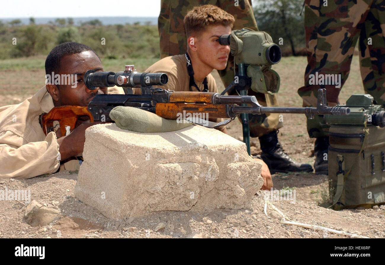 Ethiopian Pvt. Abebaw Damte fires a Dragunov sniper rifle at a shooting range outside Camp Ramrod, Ethiopia, Sept. - Stock Image