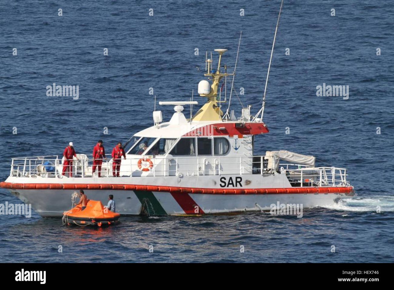 An Iranian coast guard search and rescue vessel comes to the aid of two stranded Iranian mariners in the Arabian - Stock Image