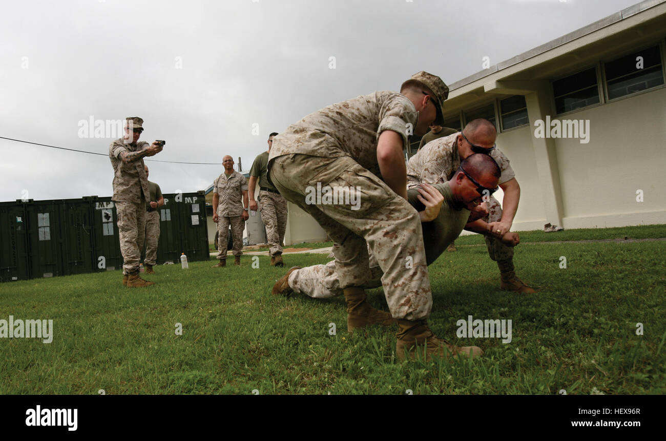 Marines and sailors with Special Operations Training Group, III Marine Expeditionary Force and Military Police Support - Stock Image