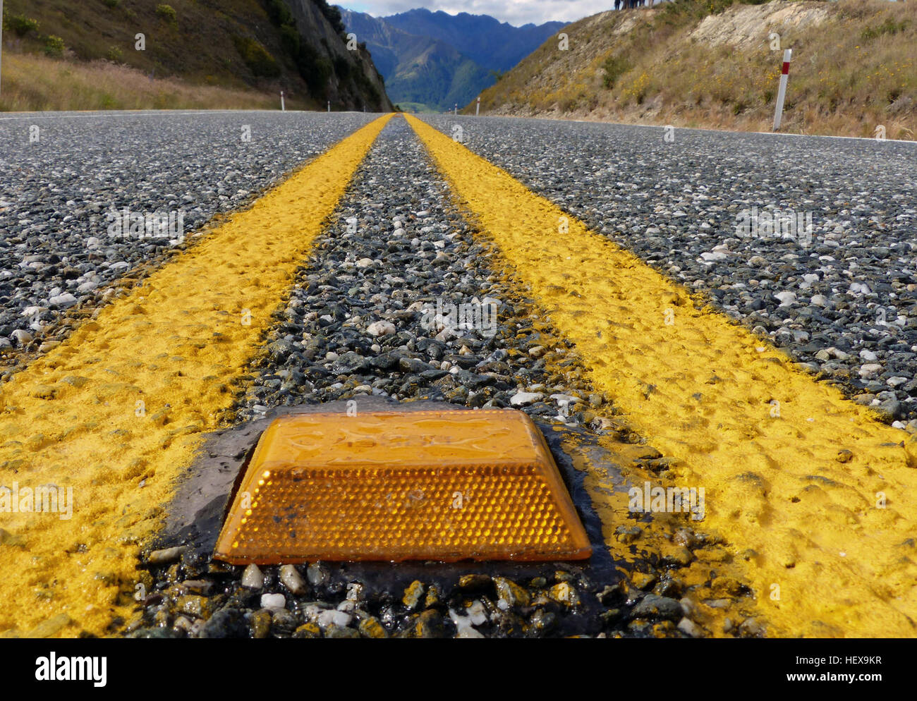 Yellow cat's eyes, road studs or retroreflective raised pavement markers (RRPMs) are used to visually reinforce - Stock Image