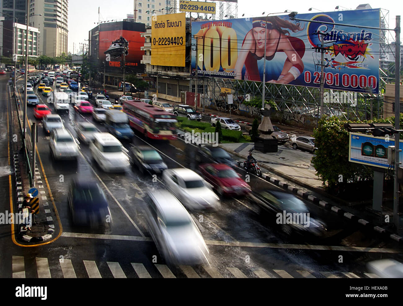 Are the roads in Bangkok always congested?  Like any other major city around the world there are commercial areas - Stock Image