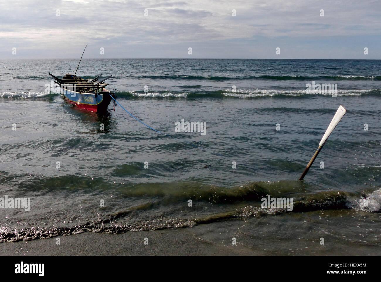 ication (,),Beach,Lumix FZ200,Ocean,Philippines,SEA,boat,oar,waves - Stock Image