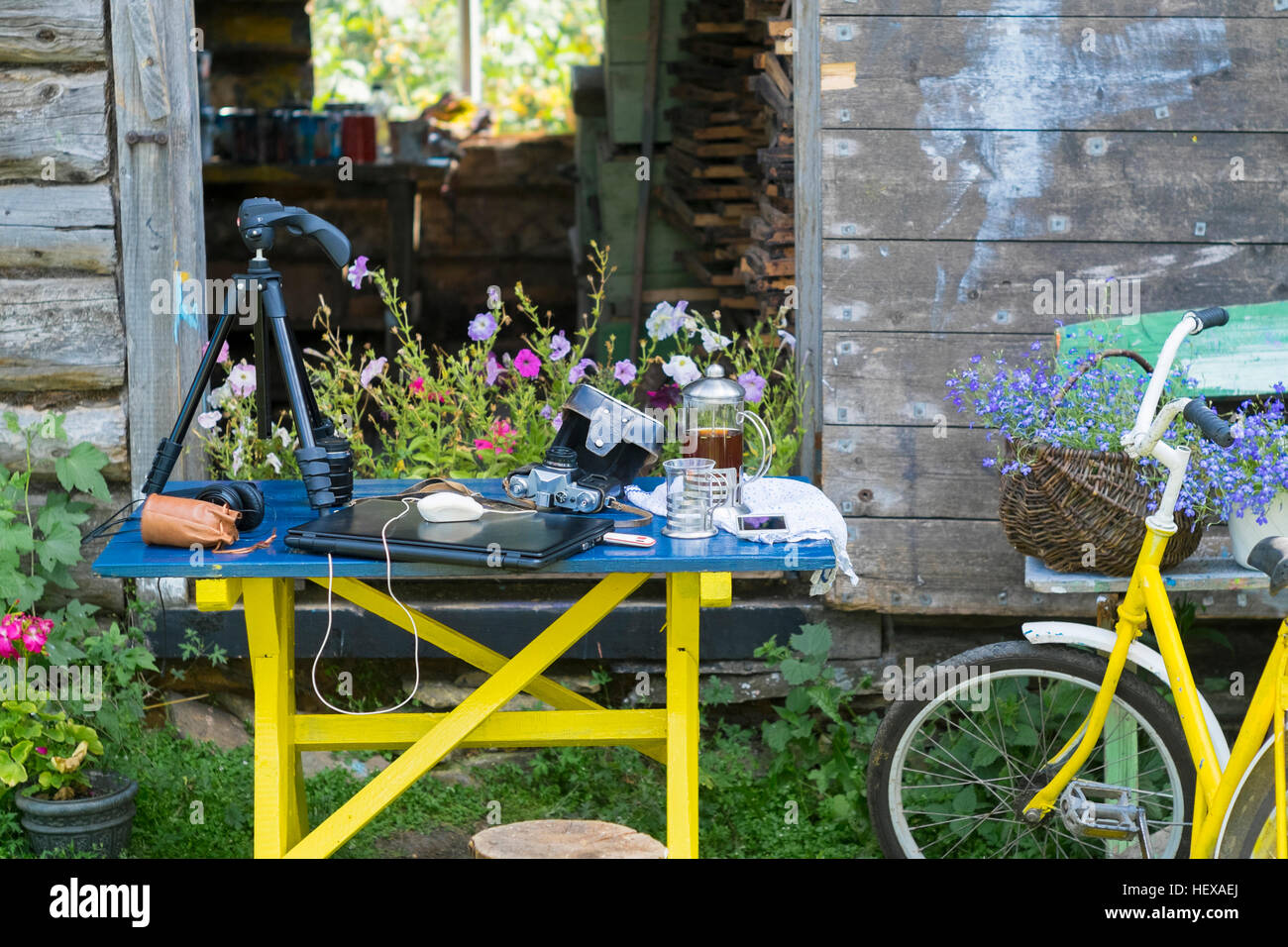 Camera equipment and laptop on table in garden Stock Photo