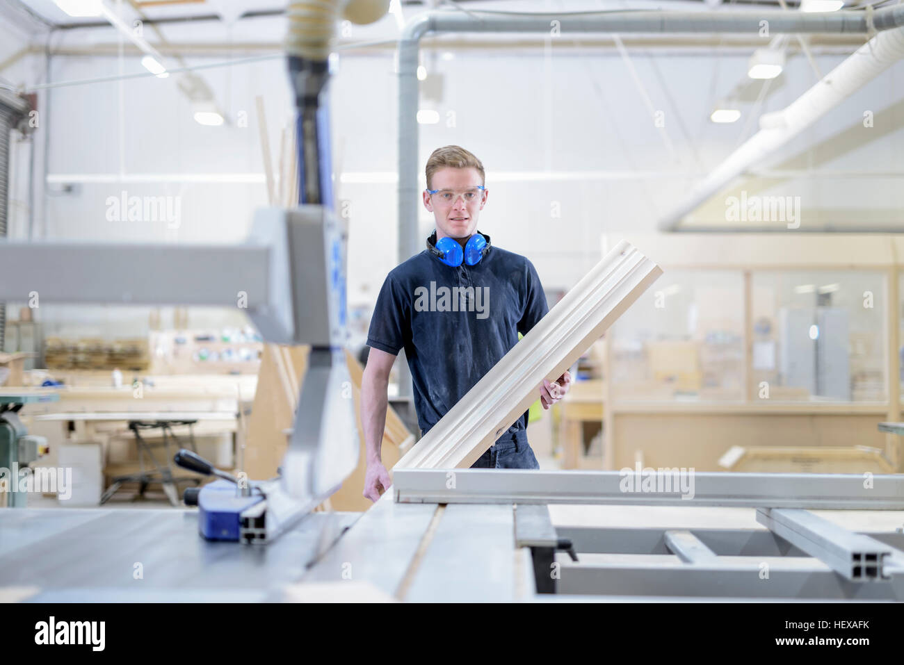 Portrait of apprentice carpenter in architectural stone factory - Stock Image