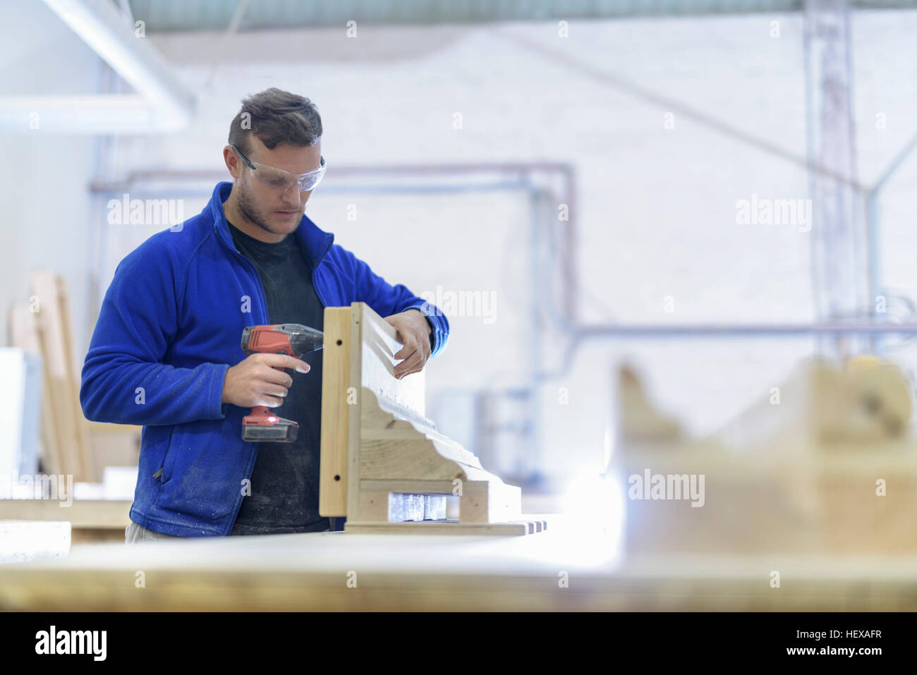 Carpenter making moulds in architectural stone factory - Stock Image