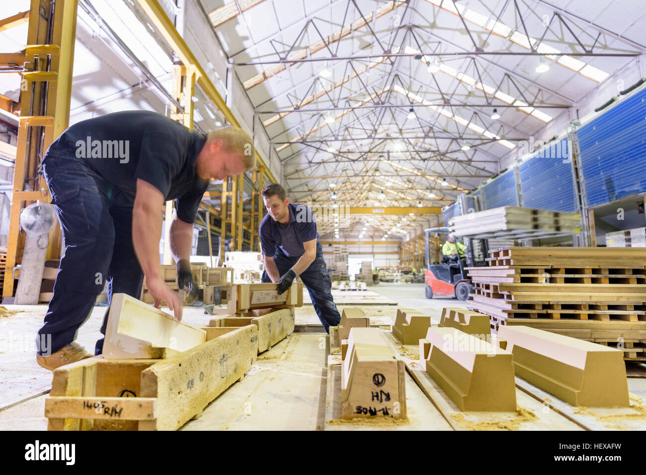 Workers moulding stone in architectural stone factory - Stock Image