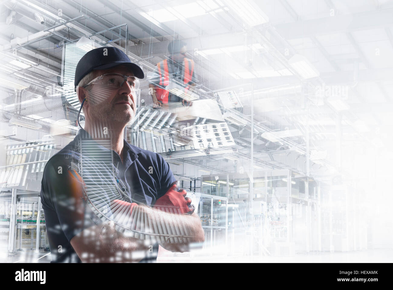 Conceptual image of factory worker in bottling plant - Stock Image