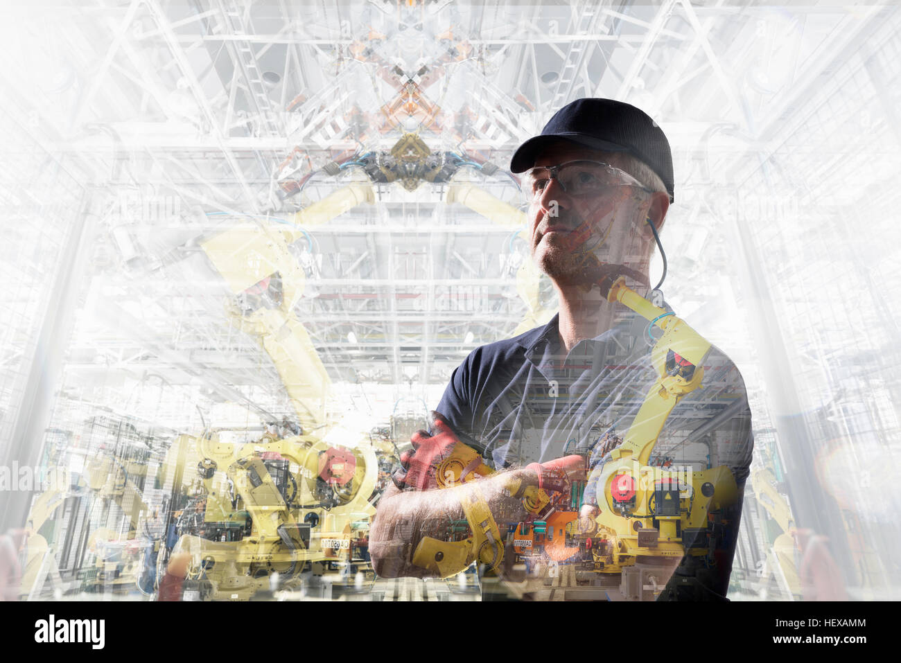 Conceptual image of factory worker in car factory - Stock Image