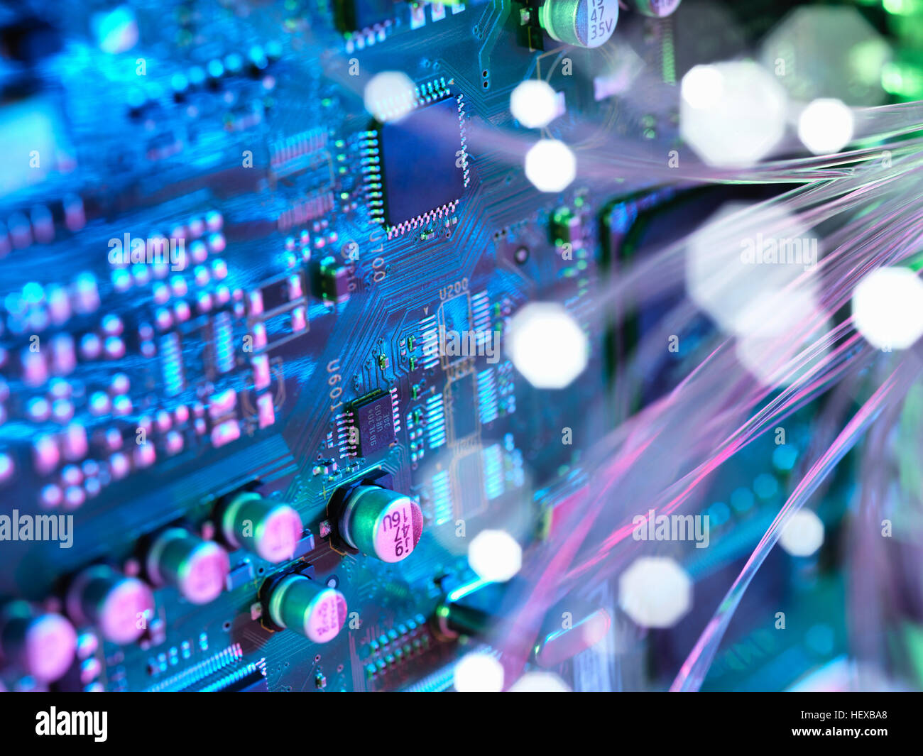 Fibre optics shooting past electronics of broadband hub - Stock Image