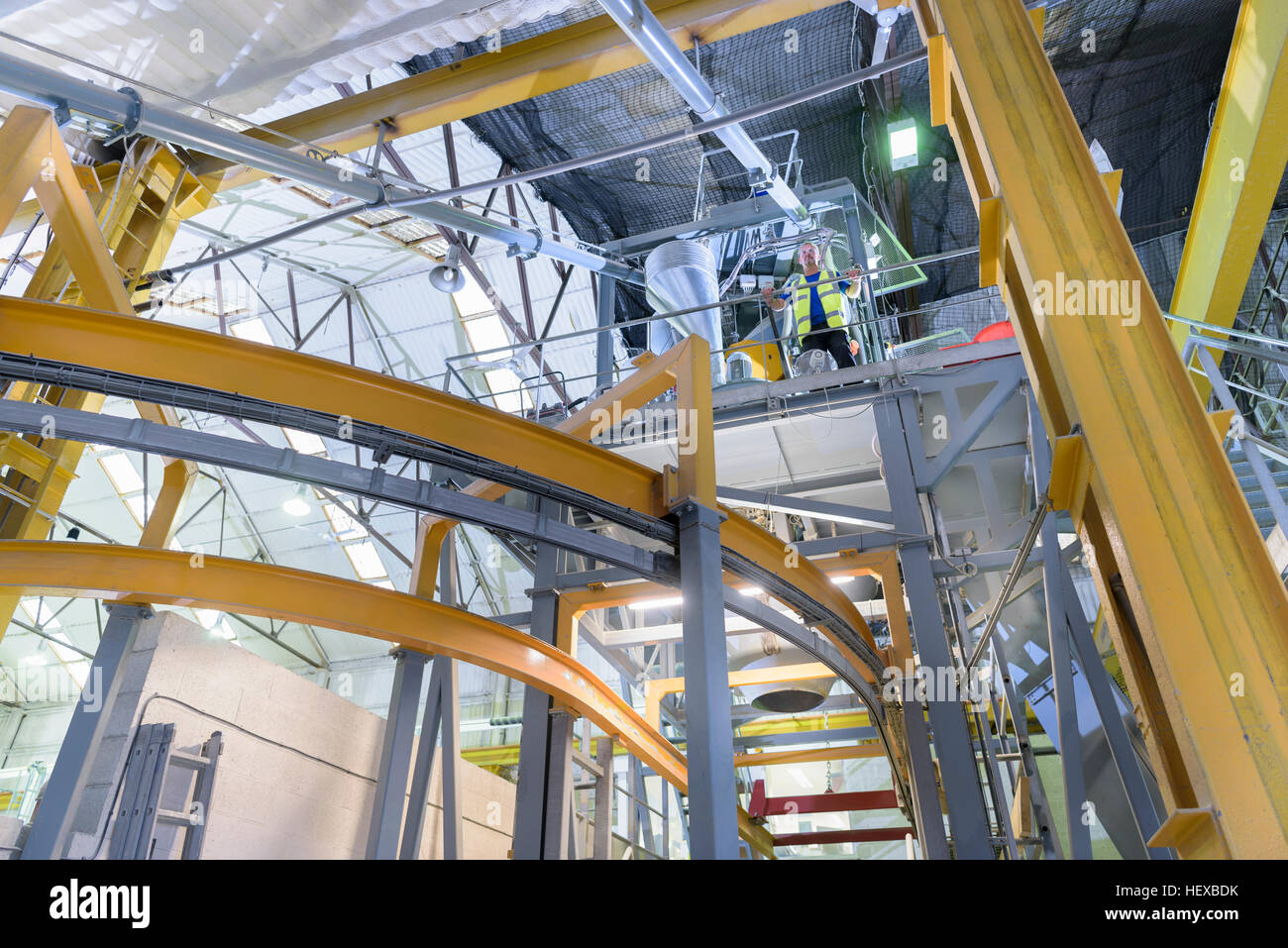 Robotic machinery in architectural stone factory, low angle view - Stock Image