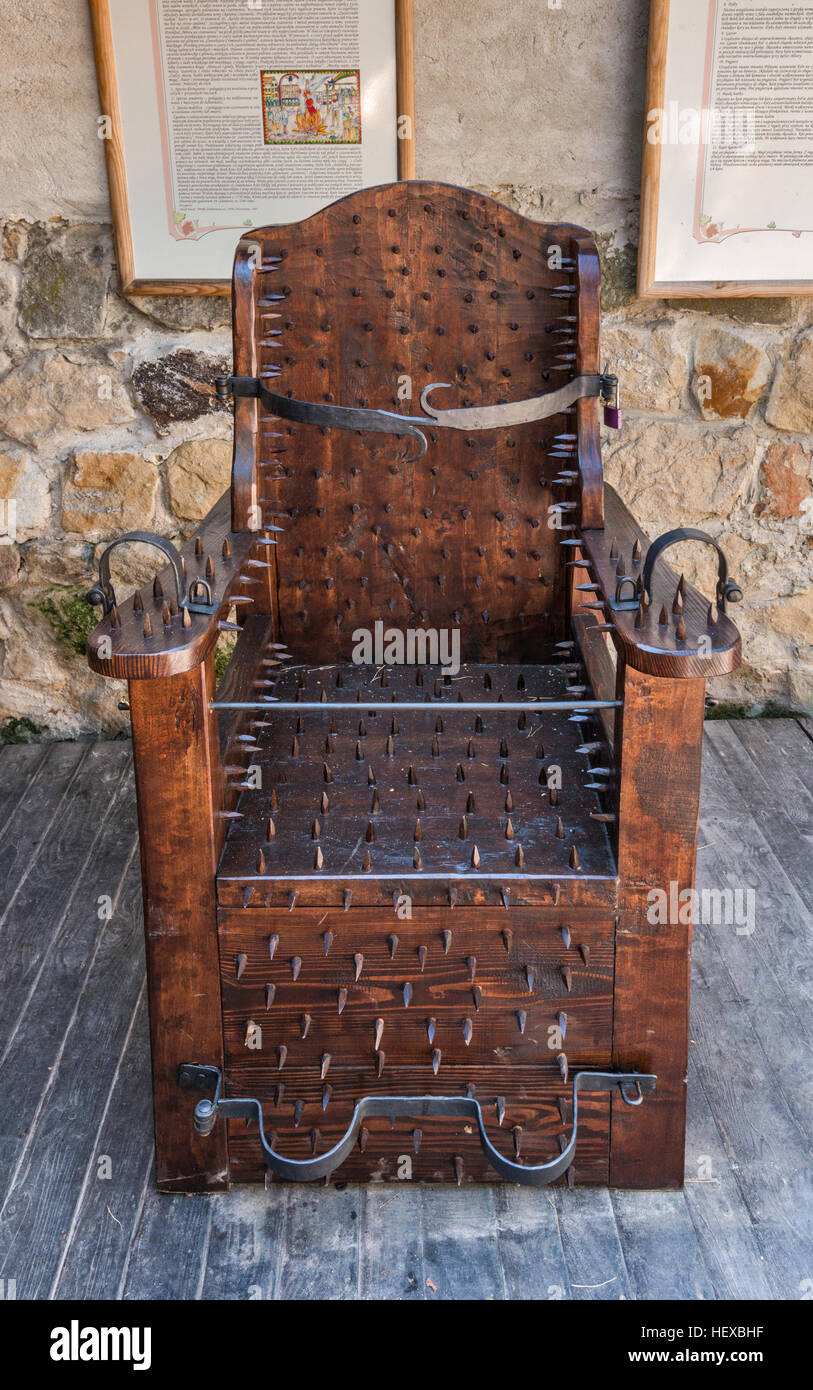 Medieval chair of torture on display at Kamieniec Castle in Odrzykon near Krosno Malopolska Poland & Medieval chair of torture on display at Kamieniec Castle in Odrzykon ...