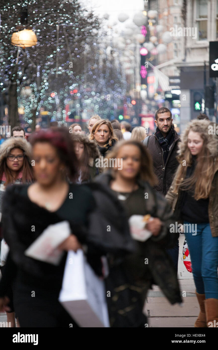 Crowds of  Christmas shoppers Oxford Street London - Stock Image