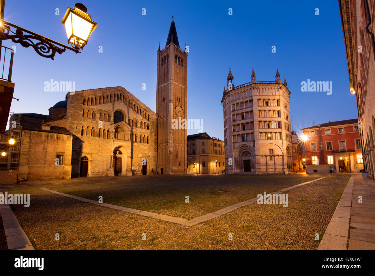 Early morning twilight over the Duomo and Baptistery in Piazza del Duomo, Parma, Emilia-Romagna, Italy - Stock Image