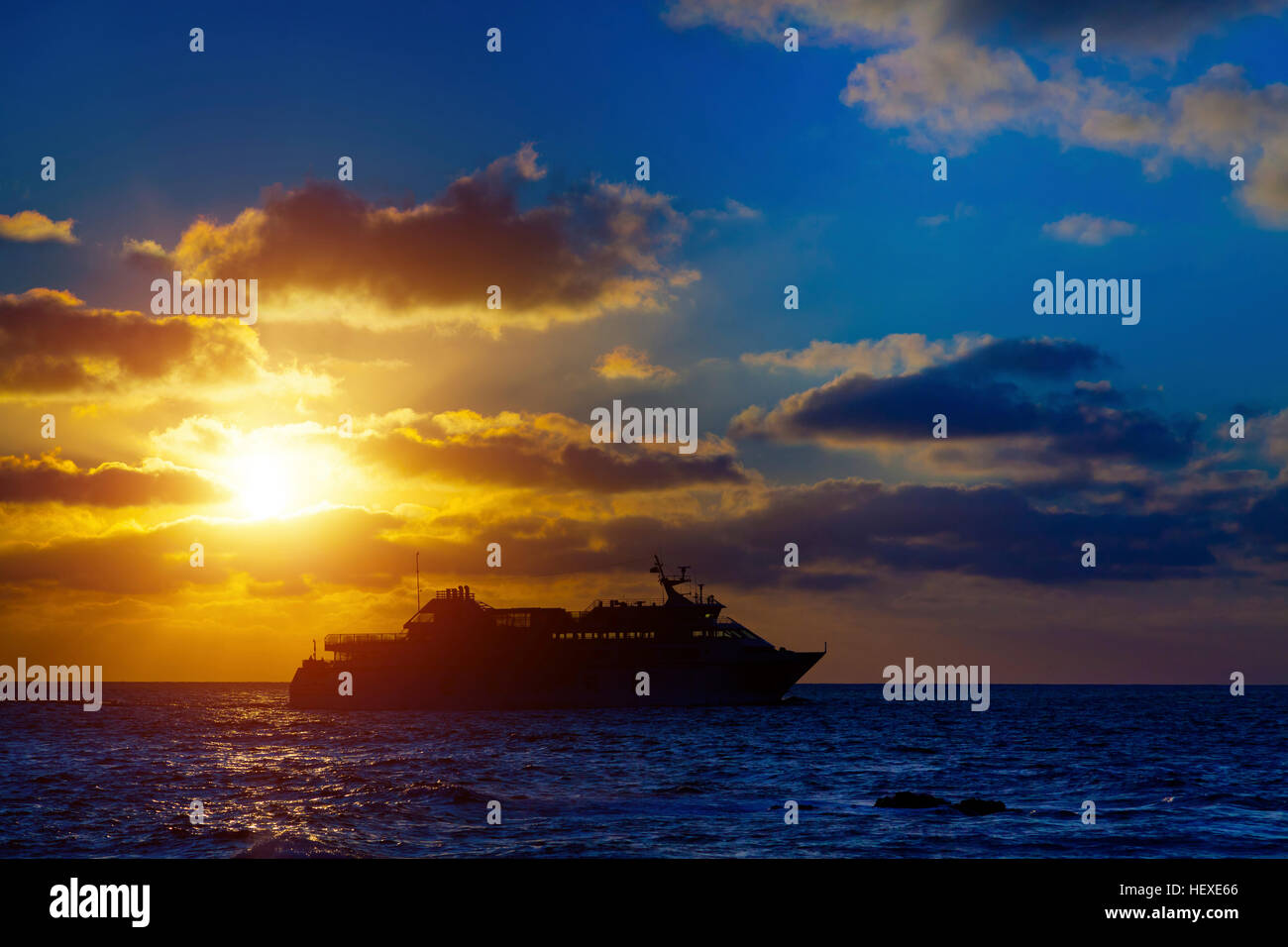 Cruise liner at sunset. - Stock Image