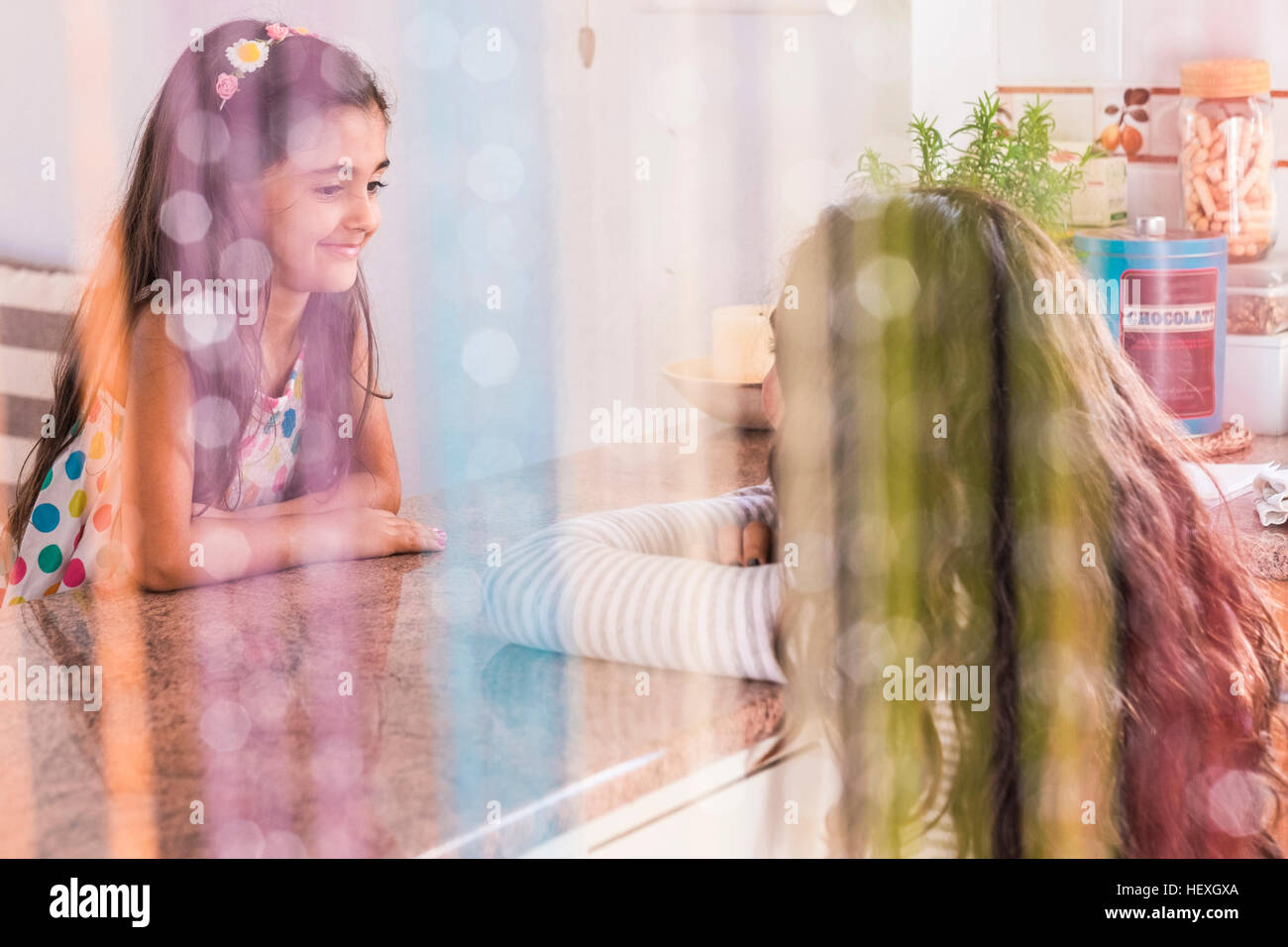 Teenage Girl And Her Little Sister In Kitchen Stock Photo 129661794